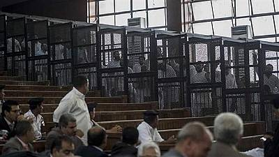 18 Egyptian trial defendants sentenced for cheering after one throws shoe at judge