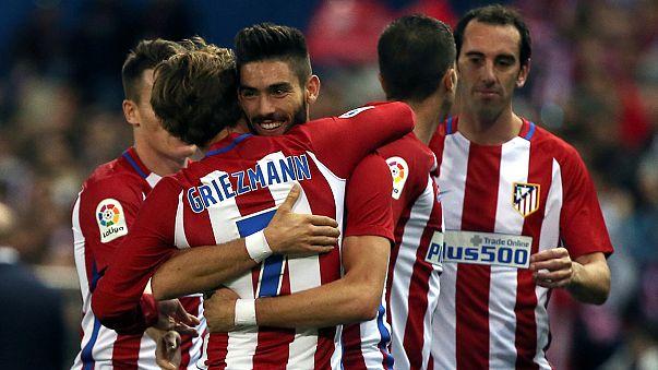 Carrasco scores a hat-trick as Atletico retain top spot in La Liga