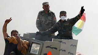 Iraqi soldiers celebrate Mosul offensive