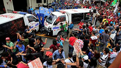 Philippine police van rams into activists outside US embassy