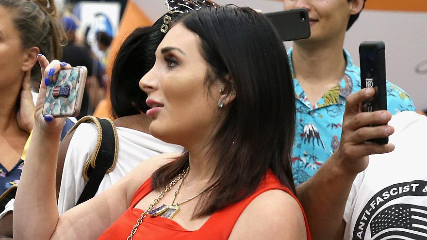 Far-right activist Laura Loomer handcuffs herself to Twitter's New York headquarters