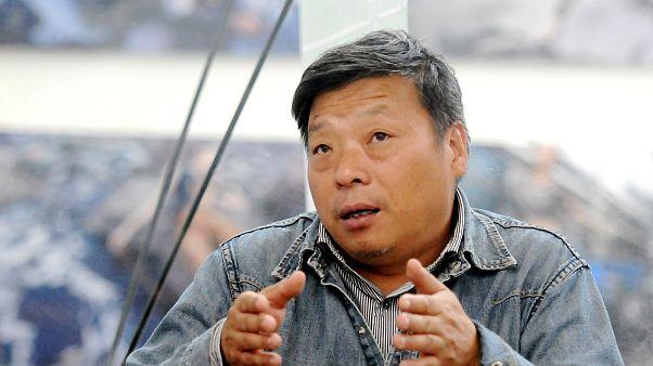 Image: Chinese photographer Lu Guang attends the Pingyao International Phot
