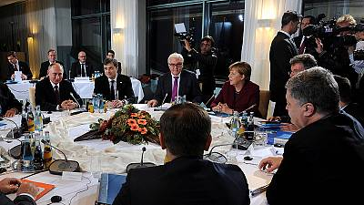 Four-way talks agree on road map to restart Ukraine's peace deal