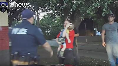 Watch: Policeman saves life of boy, three, after youngster's seizure