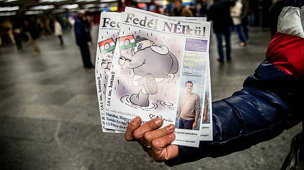 Hungary's opposition journalists take shelter in homeless magazine