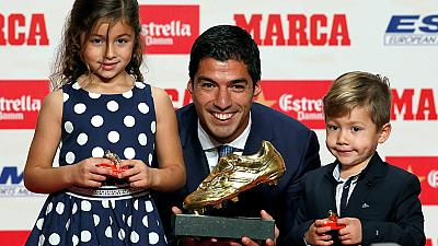 Luis Suarez' kids present the European Golden Boot trophy to him