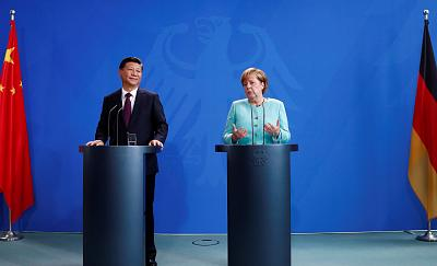 Chinese President Xi Jinping and German Chancellor Angela Merkel meet in Berlin last year.