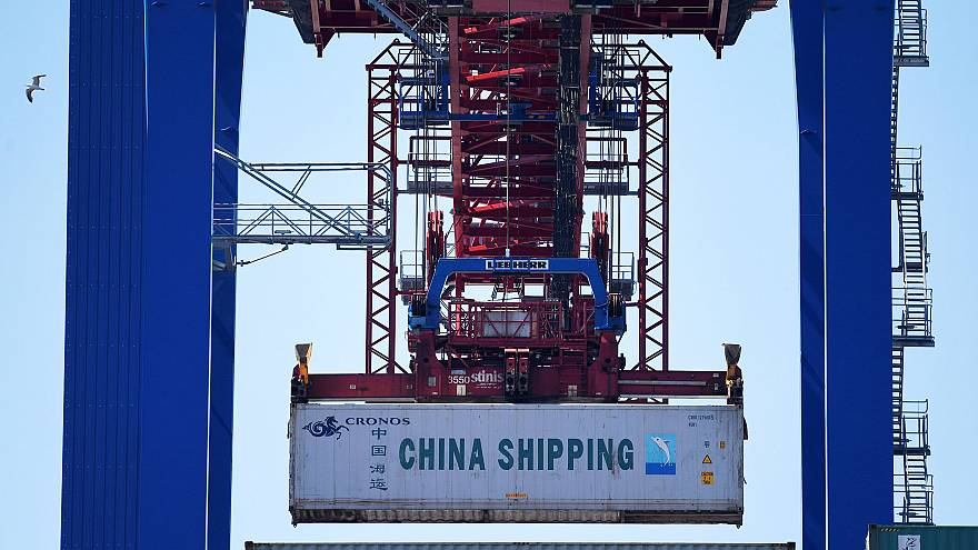 Image: A China Shipping container is loaded at a terminal in the port of Ha