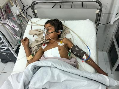 Rahmatullah lies in intensive care after an operation. His father, Obaidullah, and an older brother, Esmatullah, died in the U.S. airstrike that wounded 13 members of his extended family.