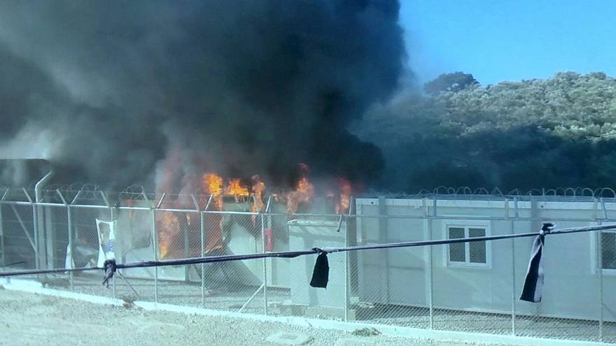 Fire at Greek migrant camp as frustrations boil over