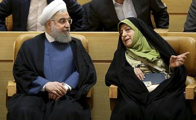 Iranian President Hassan Rouhani listens to Masumeh Ebtekar during a conference on combating sand and dust storms on July 3, 2017 in Tehran.