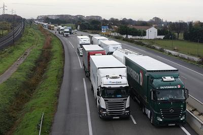 "Hundreds of trucks block a highway near Arles, France, on Sunday as part of the ""Yellow Jacket"" protests."