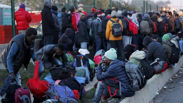 Demolition due to begin as migrants continue leaving Calais 'Jungle'