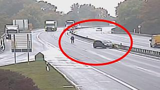 Video: Man chases runaway car across busy motorway