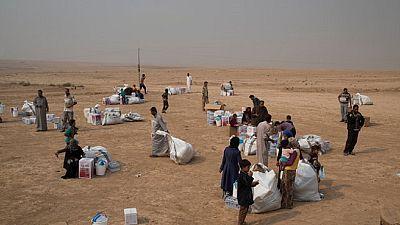 Les familles fuient Mossoul (Irak)