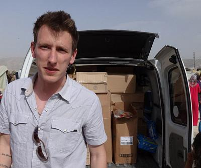 Peter Kassig with a truck filled with supplies for Syrian refugees.