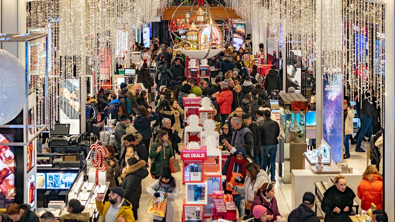 People shop at Macy's for the early Black Friday sales in New York on Nov.