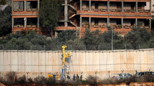 Image: Israeli soldiers standing by machinery near the border wall with Leb