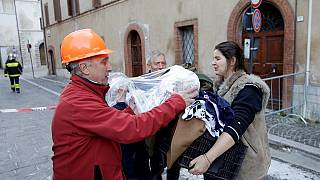 Rescuers help residents affected by overnight quake in central Italy