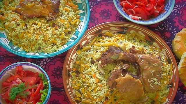 Enjoying a traditional Uzbek dish called plov