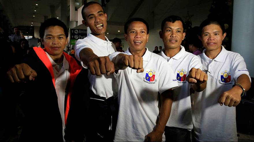 Filipino sailors freed by pirates arrive home in Manila