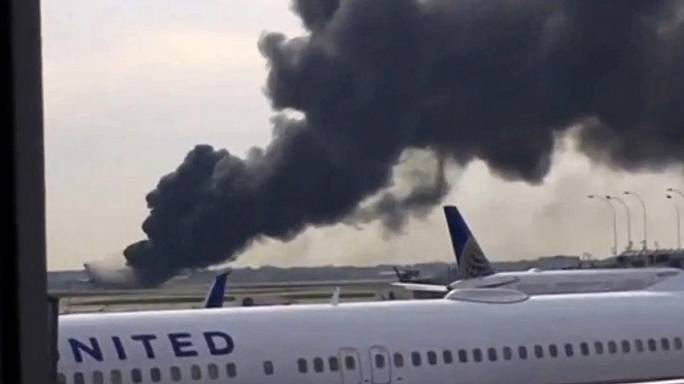 Dramatic scenes as plane engine catches fire in the US