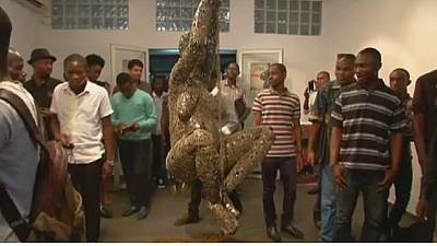 Congo sculptor brings objects of war to life