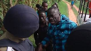 Popular shirt of Ugandan opposition leader Besigye ripped during arrest