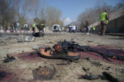 A sandal lies on the ground after a suicide bombing near Kabul University on March 21.