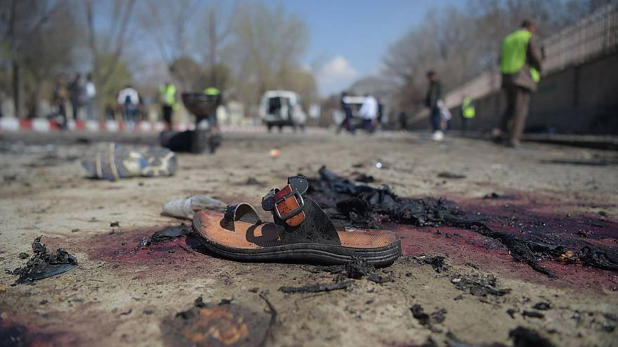 Image: A sandal lies on the ground after a suicide bombing near Kabul Unive