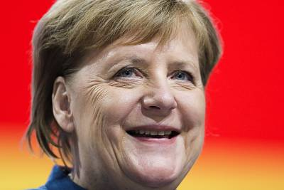 German Chancellor Angela Merkel welcomes delegates to the party convention on Friday.
