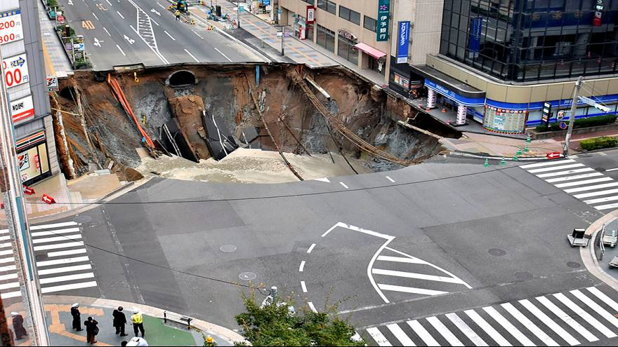 Watch: Large sinkhole opens up in Japan swallowing four-lane crossroad