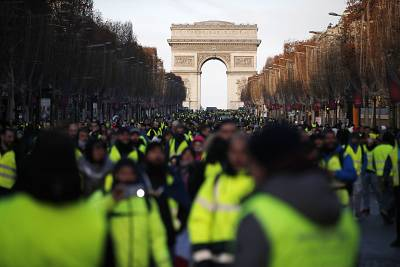 Yellow Vests protesters walk down the Champs Elysees on Saturday.