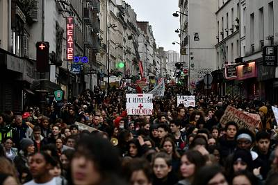 High school students hold banners during a demonstration march from place Stalingrad to place de la Republique in Paris on Dec. 7, 2018 to protest against the different education reforms including the overhauls and stricter university entrance requirements.