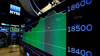 Dow Jones surges to record high