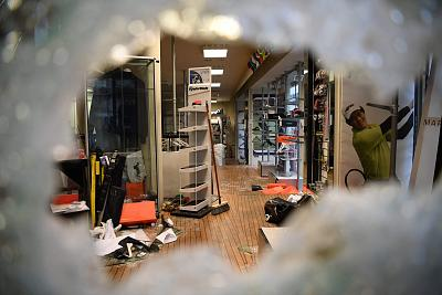 "A damaged golf shop window on Marceau avenue in Paris, a day after a ""yellow vest"" protests as part of a fourth weekend of nationwide protests on Dec. 9, 2018."