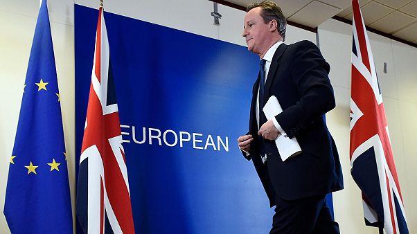 Image: British Prime Minister David Cameron leaves after delivering a press