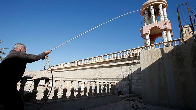 Restoring faith: Crucifix replaced above newly-liberated Bashiqa church in Iraq