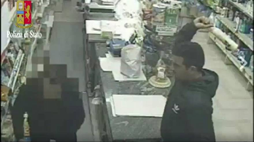 Watch: Robber smashes shopkeeper with bottle in raid in Italy