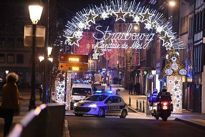 A police car drives in the streets of Strasbourg, eastern France, after a shooting on Dec. 11.