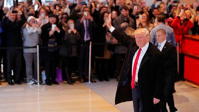 Trump appears to backtrack on pledges over Clinton and climate change