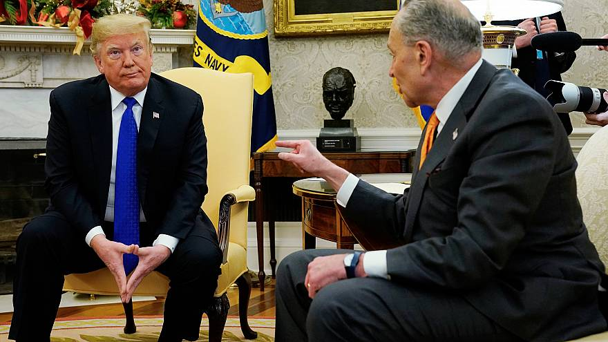 Image: President Donald Trump listens to Senator Chuck Schumer at the White