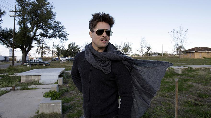 Image: Brad Pitt walks in the Lower 9th Ward where homes are being built fo