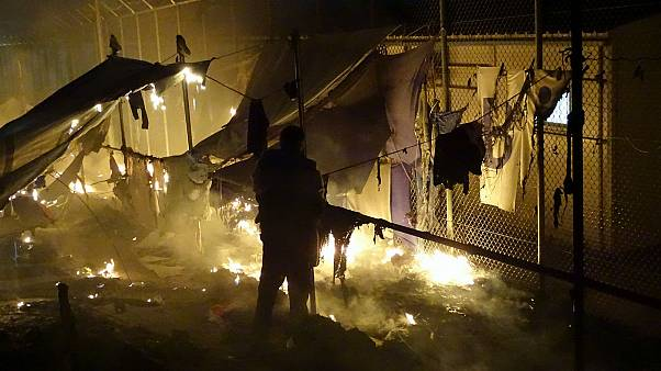 Greece: migrants set fire to Lesbos refugee camp after two die in gas blast