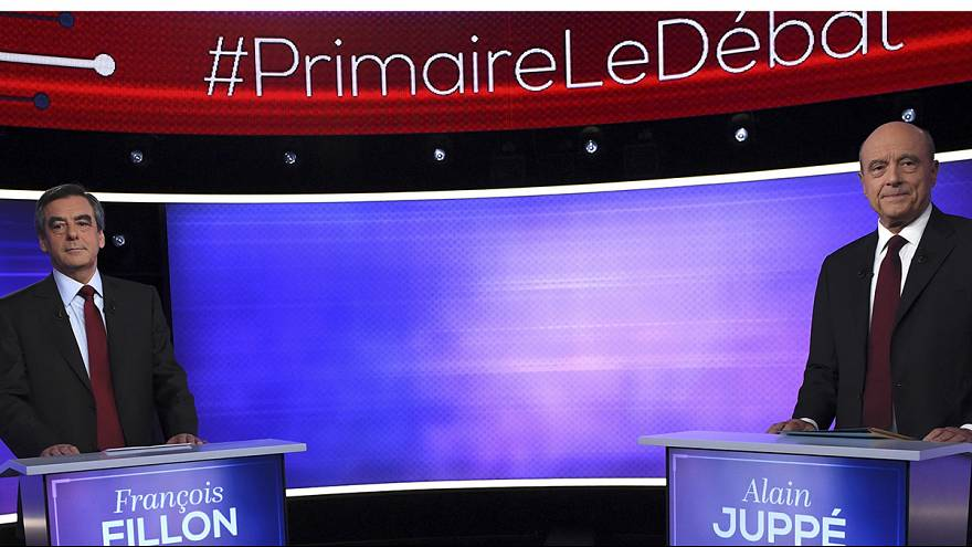 French conservative rivals Fillon and Juppé clash on Russia in TV debate