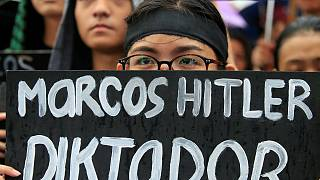 Angry Filipinos march against burial with military honours of Ferdinand Campos