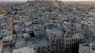 Residentes de Alepo em fuga