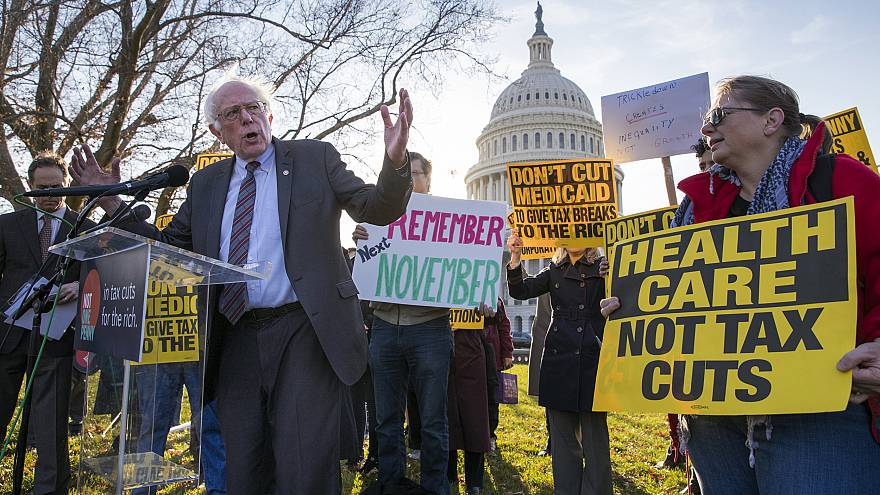 Image: Sen. Bernie Sanders joins protesters outside the Capitol as Republic