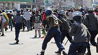 Teargas and water cannon as Zimbabwe police disperse 'local dollar' protest