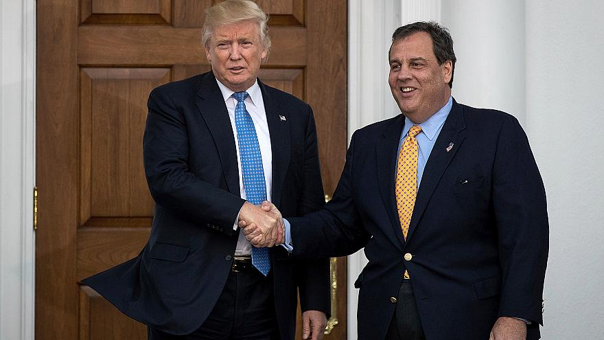 Donald Trump and Chris Christie shake hands before their meeting at Trump I